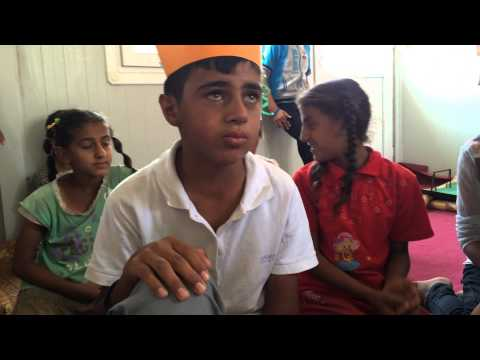 Syrian refugee boy singing lament in Iraq refugee camp. Music is therapy!