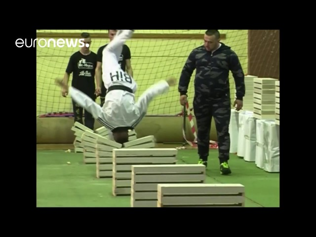 Taekwondo champion smashes 111 building blocks with his head