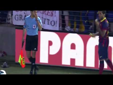 Daniel Alves eats banana thrown from crowd vs Villareal