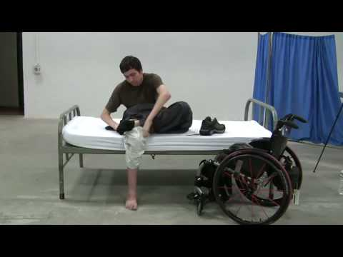 Quadriplegics: bed mobility and dressing