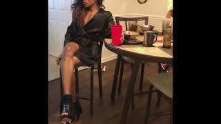 Lady walking in high heels falls over