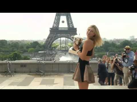 French Open winner Maria Sharapova shows off her trophy in Paris