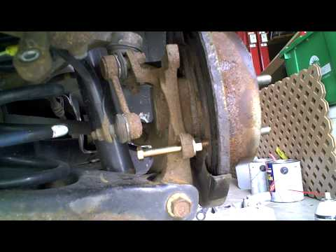 How to Remove the Brake Rotor from a 2006 Hyundai Sonata