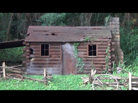 NEW Smoking Settler's Cabin (Formerly Burning) as Seen from Liberty Belle Riverboat, Magic Kingdom