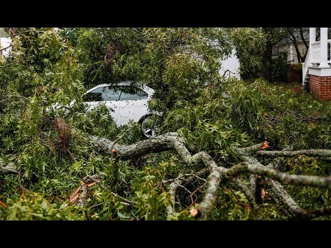 Florence downgraded as death toll climbs