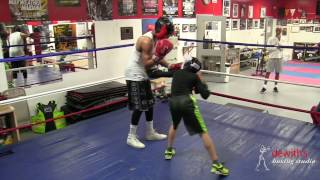 Amateurs sparring inside Dewith's Boxing Studio
