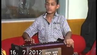 Song played on Harmonium by a 12 years old child Master Nishad  YouTube