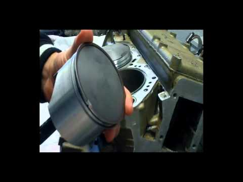 How to install Outboard Pistons when rebuilding your outboards motor