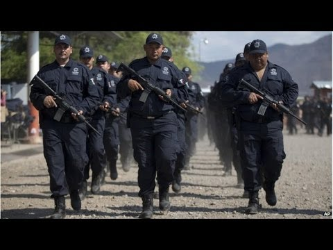 Mexico begins swearing in former vigilantes for new Michoacan force
