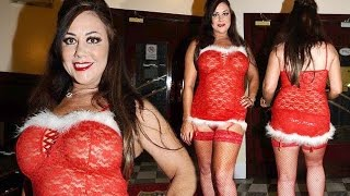 Big Brother star Lisa Appleton is feeling festive as she slips into thigh skimming Santa dress and f