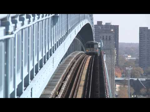 Patco and Septa Trains going over and under Ben Franklin Bridge