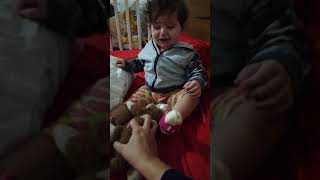 angela - baby 10 months scared of toy monkey