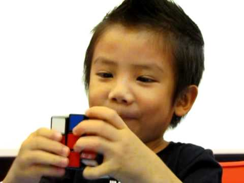 Watch 4 year old solves Rubik's Cube in 60s