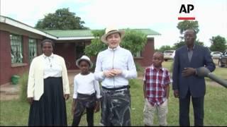 Download Madonna adopts twin girls in Malawi 3Gp Mp4
