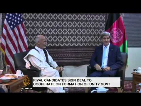 Afghan election rivals pledge to back deal