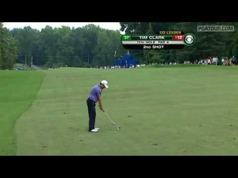 In the third round of the Wyndham Championship, Tim Clark hits his 160-yard approach shot to inches on the par-4 11th hole and taps for birdie.