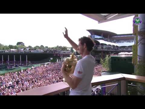 Andy Murray shows off his second Wimbledon trophy