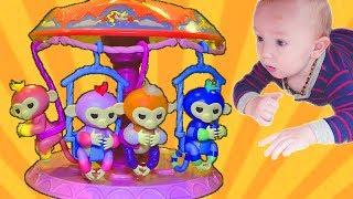 Little baby plays with colorful monkey toys