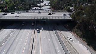 Boulder pushed off California overpass kills man in car