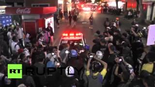 (Brazil) Protesters flee Rio riot cops  6/21/14