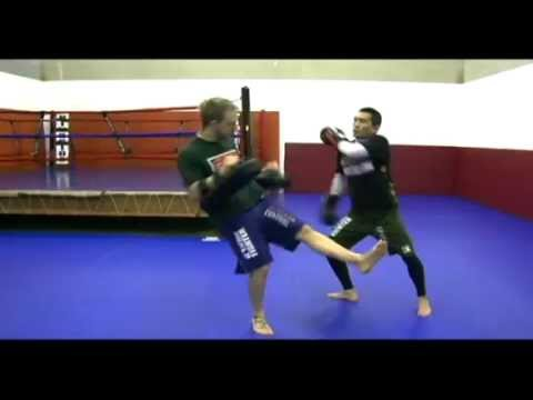 Basic Muay Thai Pad Drills: Inside Left Kick Counters Image 1
