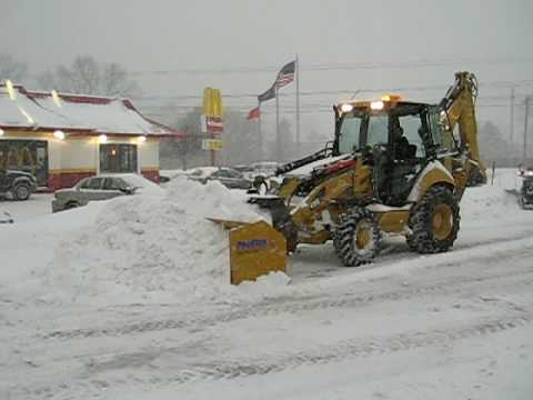 Cat 420E Backhoe Plowing Snow with Pro-Tech pusher
