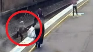 Woman saves schoolgirl from train tracks with seconds to spare