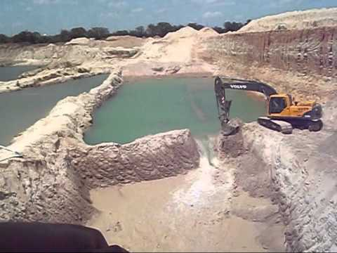 Volvo Excavator Breaks Down a Small Dam