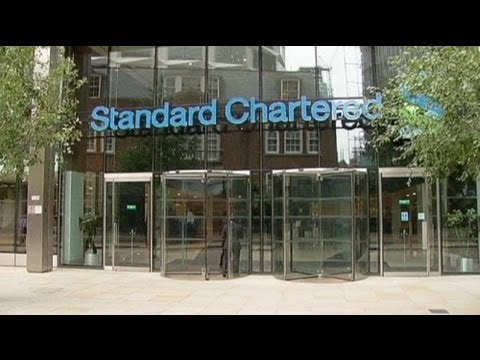 StanChart worried about regulatory costs despite record profit