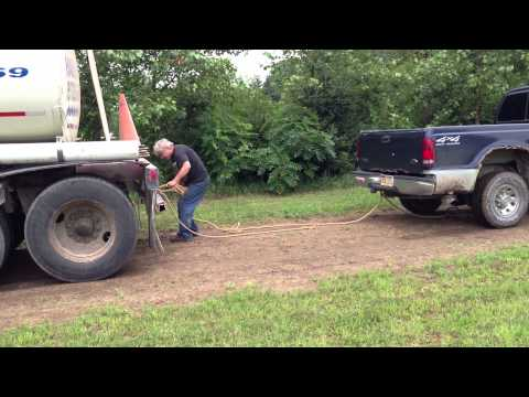 Ford F250 4x4 diesel Truck pulling a Semitruck out of mud.