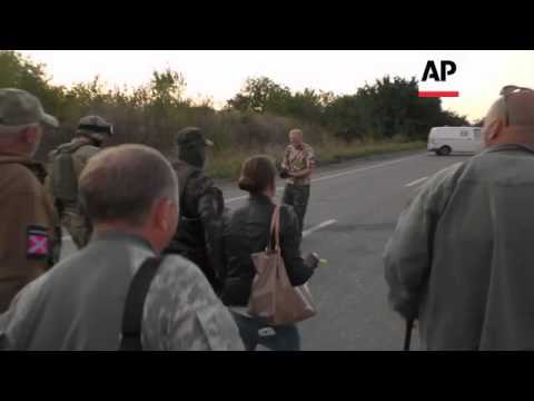 Ukrainian troops and Russian-backed rebel forces exchange prisoners