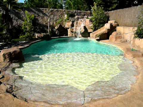 Piscinas tipo playa en roca artificial rocasyelica youtube for Modelos de piscinas con jacuzzi