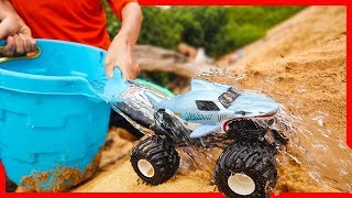 Toy Monster Trucks for Kids Playing At the Beach