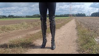 156 black over knee boots crushing glasses