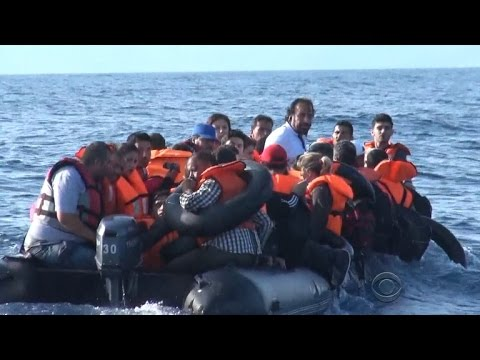 Boats from Greece confront refugees at sea with guns