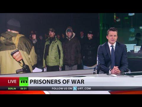 Ukraine army & militia exchange prisoners, 100s released