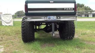 HUGE LIFTED UP 4X4 FORD TRUCK WITH LIFT KIT AND BIG TIRES IT IS FOR SALE IN FLORIDA