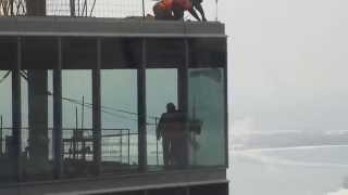 TO High Rise-construction workers installing window on 38th flr Part3