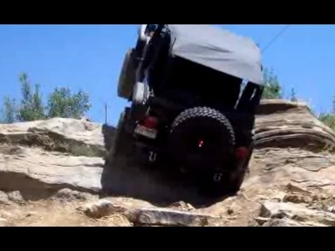 Extreme 4X4 Action! Near Vertical Wheel Stand On Steep Rock Hill. Jeep Wrangler Rubicon TJ
