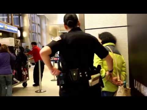 Los Angeles Airport Police arrest a  Woman after assaulting a a man