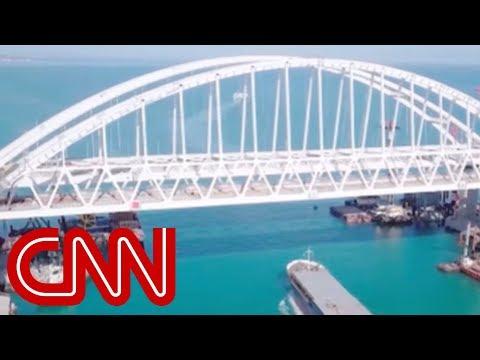 Putin opens new bridge, defies the world