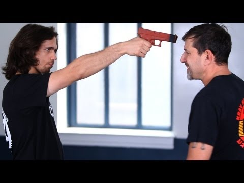 How to Defend against a Gun to the Face | Krav Maga Defense Image 1