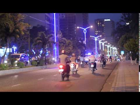 Night traffic on asian road, bikes and cars, stock video