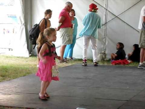 Caroline dancing at her first Jazz Fest