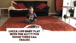 Lucca and Baby the kitten play with the super fun Zoom Tubes Car Tracks