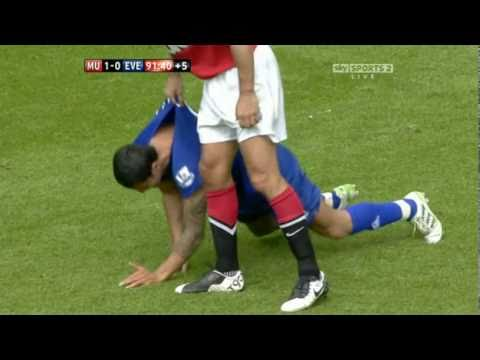 Rio Ferdinand picks up Tim Cahill by the shirt
