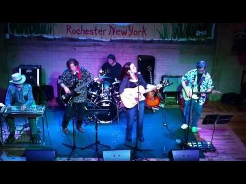 Sarah Rush and Silvernail Perform Famous Blue Raincoat