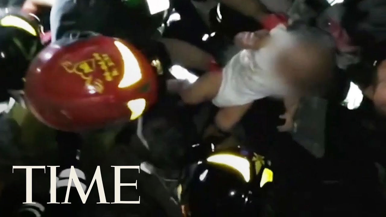 Firefighters Rescued An Infant From The Rubble Hours After An Earthquake Shook Ischia, Italy | TIME