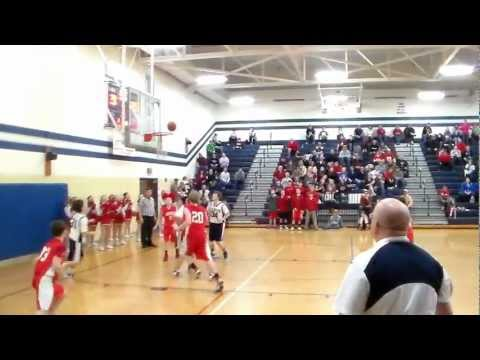 Buzzer beater while laying on floor: Blanchester 8th grade boy makes shot while laying on floor