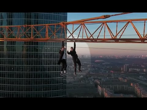 Extreme Climbers Hang From Moscow Crane for Illegal Stunt